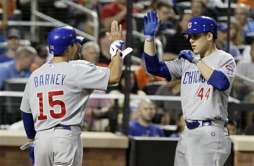 Chicago Cubs' Anthony Rizzo (44) celebrates with Darwin Barney (15) after hitting a three-run home run during the fifth inning of a baseball game against the New York Mets on Friday, July 6, 2012, in New York. (AP Photo/Frank Franklin II)