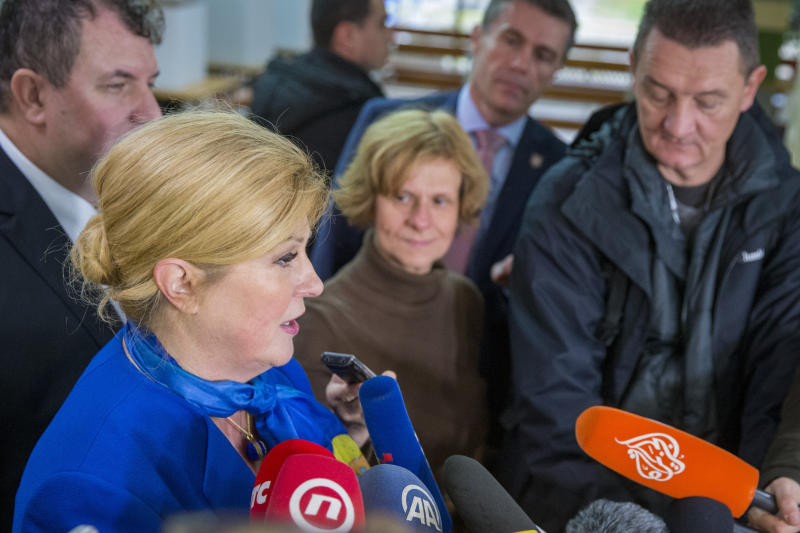 Incumbent president Kolinda Grabar Kitarovic addresses the media after her vote at a polling station in Zagreb, Croatia, Sunday, Dec.22, 2019. Voters in Croatia go to the polls Sunday to pick a new president in a tight, holiday-season election race that is pitting the conservative incumbent against the left and right wing challengers. (AP Photo/Darko Bandic)