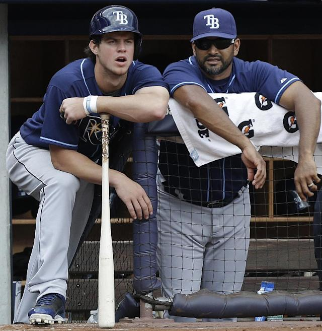 Tampa Bay Rays Wil Myers, left, and bench coach Dave Martinez watch in the ninth inning of a 3-1 victory over the New York Yankees in a baseball game on Sunday, June 23, 2013, in New York. (AP Photo/Kathy Willens)