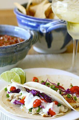 "<strong>Get the <a href=""http://www.annies-eats.com/2010/08/10/white-fish-tacos/"" rel=""nofollow noopener"" target=""_blank"" data-ylk=""slk:white fish tacos recipe"" class=""link rapid-noclick-resp"">white fish tacos recipe</a> by Annie's Eats.</strong>"