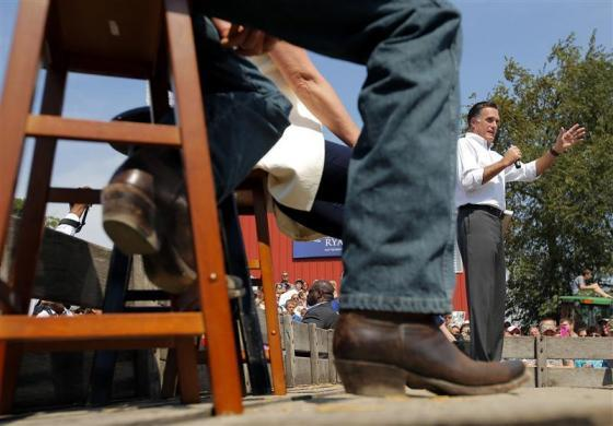Mitt Romney is seen past the boots of Paul Ryan as he speaks during a campaign rally at the Long Family Orchard and Farm in Commerce, Michigan August 24, 2012.