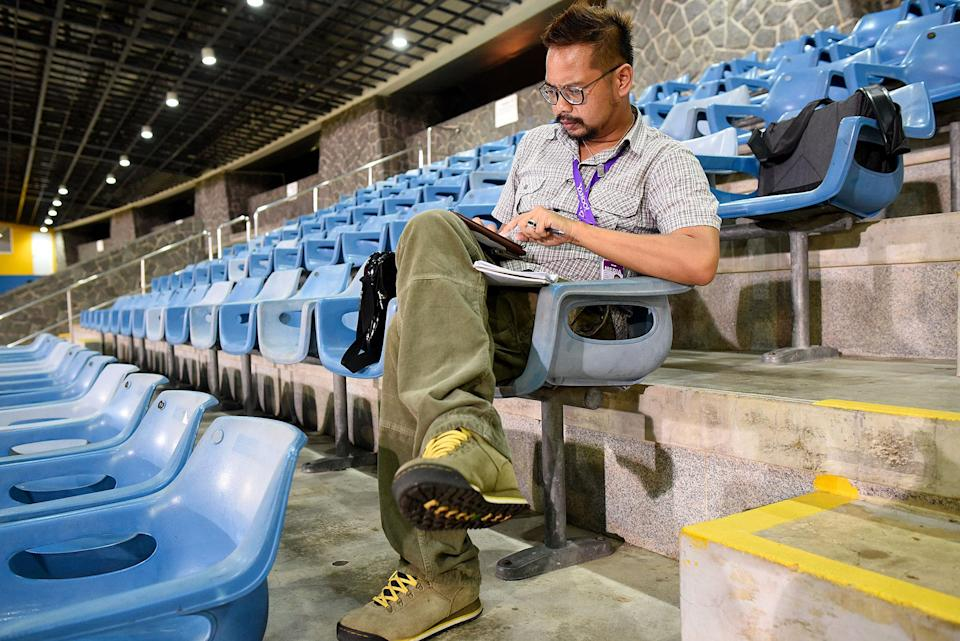 Safhras on the job covering the Bukit Batok by-election in 2016. (PHOTO: Bryan Huang / Yahoo News Singapore)
