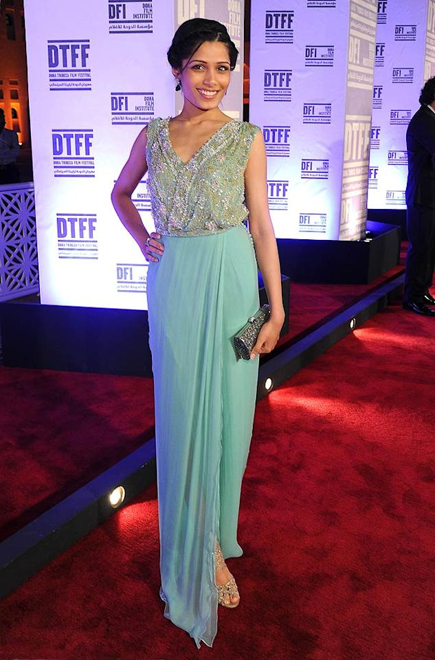 """Slumdog Millionaire"" alum Freida Pinto put her best foot forward at the ""Miral"" premiere during the 2010 Doha Tribeca Film Fest in a breathtaking, turquoise-colored Dior dress, which featured an embellished bodice and a chiffon skirt. Michael Buckner/<a href=""http://www.gettyimages.com/"" target=""new"">GettyImages.com</a> - October 28, 2010"