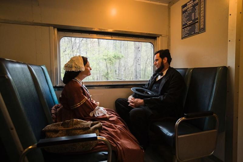 Members of the Lincoln Presenters conference take the scenic and historic train from Blue Ridge to McCaysville on April 12. Here, Teena Baldrige, 67, of Springboro, Ohio, chats with James Mitchell, 54, from Hope, Kan. | Benjamin Norman for TIME