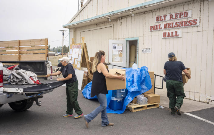 Volunteers unload donated lunches at the Bly Fire Department in Bly, Ore., on July 31, 2021. (Jim Seida / NBC News)