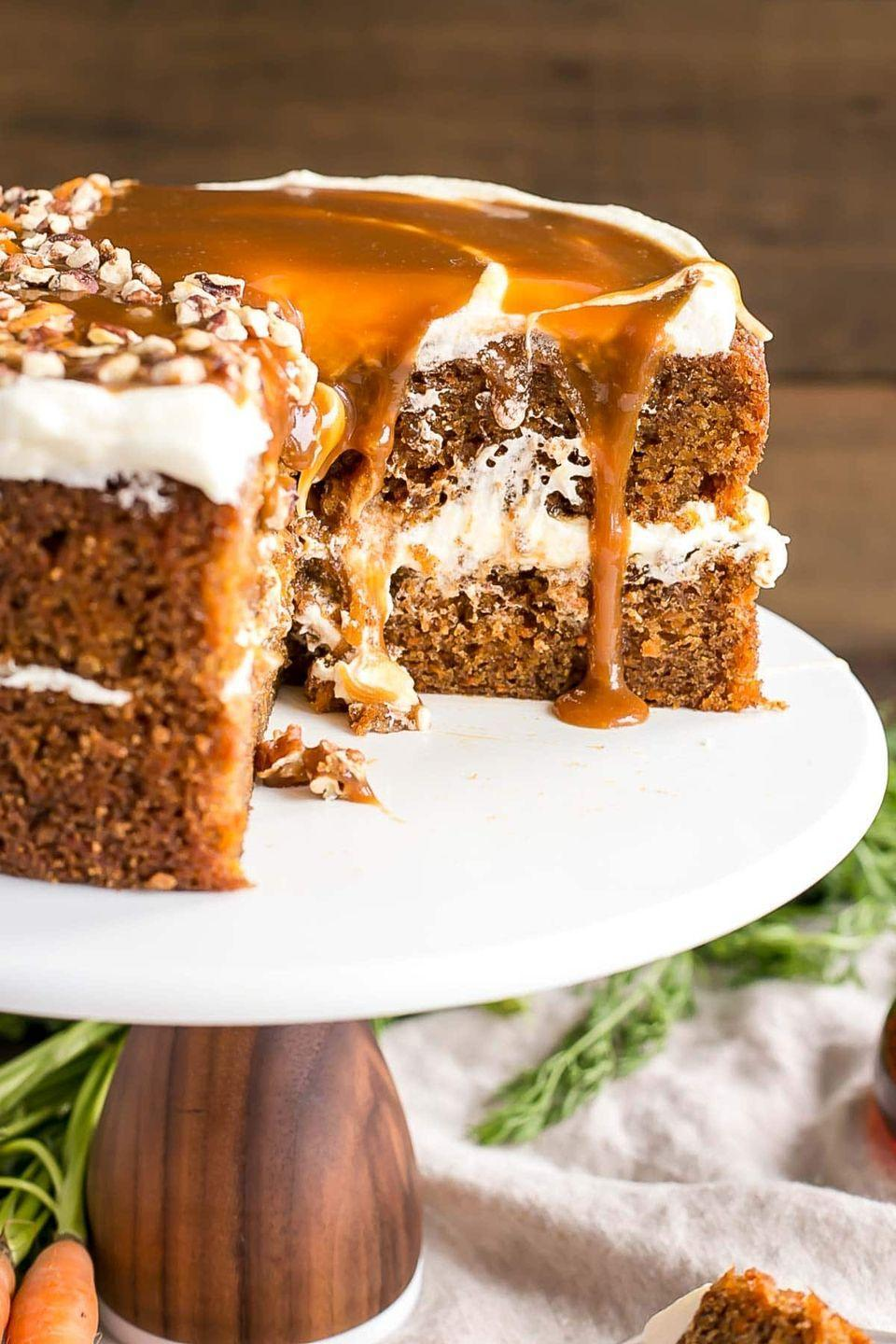 "<p>It turns out that pouring maple caramel sauce on top of a carrot cake will make it out-of-this-world good.</p><p><strong>Get the recipe at <a href=""https://livforcake.com/maple-caramel-carrot-cake/"" rel=""nofollow noopener"" target=""_blank"" data-ylk=""slk:Liv for Cake"" class=""link rapid-noclick-resp"">Liv for Cake</a>.</strong></p><p><strong><a class=""link rapid-noclick-resp"" href=""https://go.redirectingat.com?id=74968X1596630&url=https%3A%2F%2Fwww.walmart.com%2Fsearch%2F%3Fquery%3Dcake%2Bstand&sref=https%3A%2F%2Fwww.thepioneerwoman.com%2Ffood-cooking%2Fmeals-menus%2Fg35408493%2Feaster-desserts%2F"" rel=""nofollow noopener"" target=""_blank"" data-ylk=""slk:SHOP CAKE STANDS"">SHOP CAKE STANDS</a><br></strong></p>"