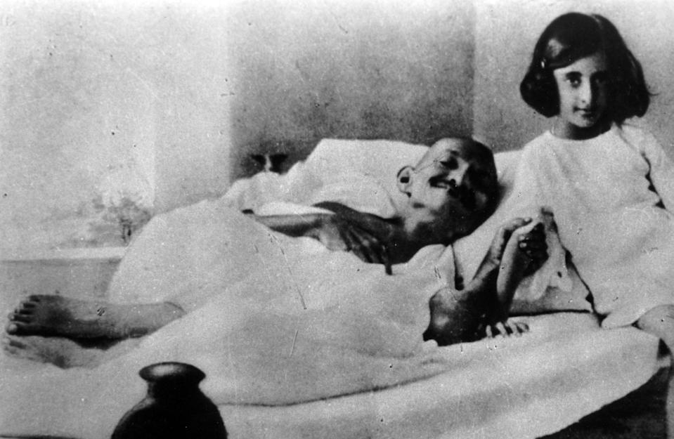 Indira Priyadarshini Gandhi, the third Prime Minister of India, as a girl next to Mahatma Gandhi. (Photo by: Universal History Archive/Universal Images Group via Getty Images)
