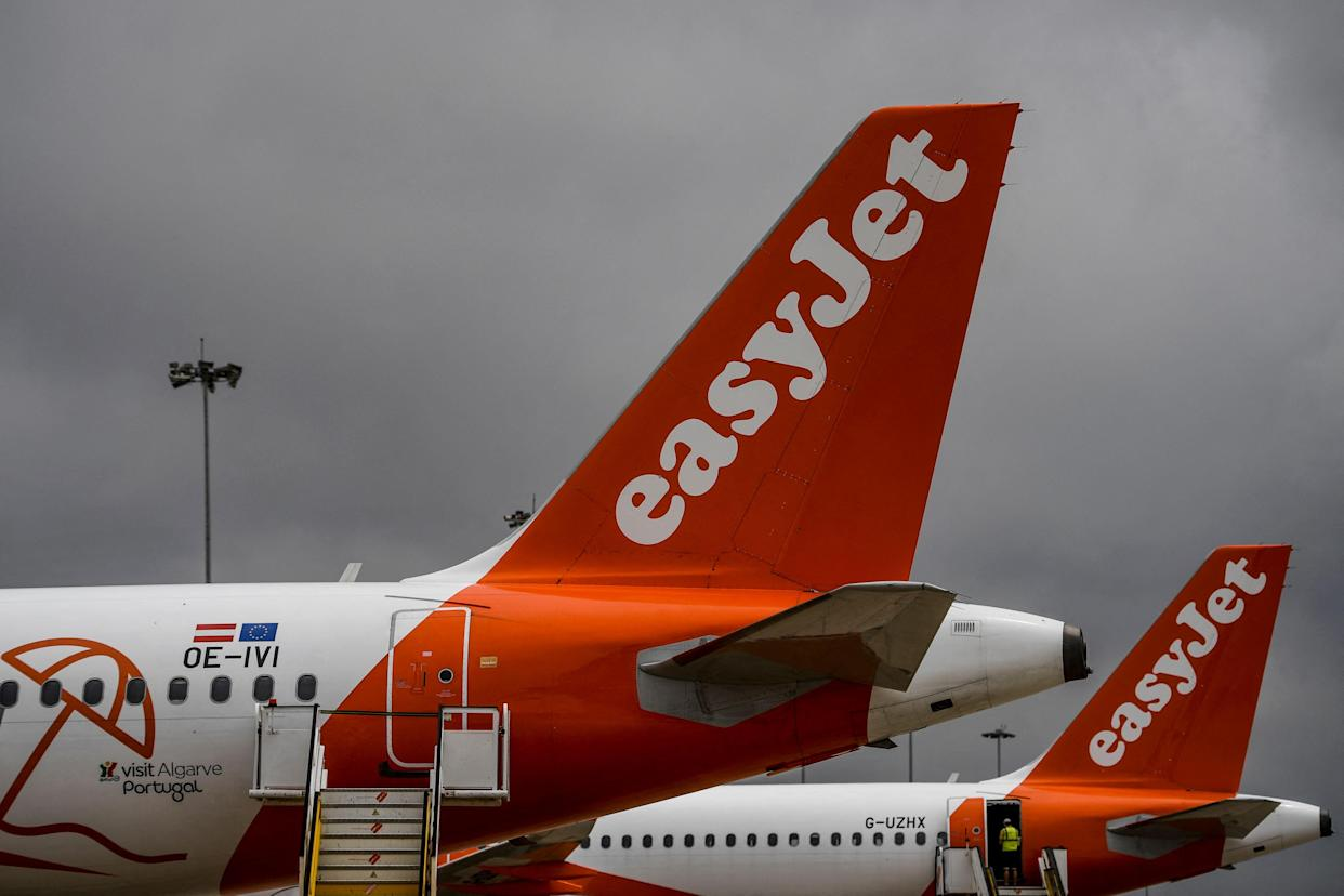EasyJet aircrafts are pictured at Faro airport in Algarve, south of Portugal, on June 15, 2021. - British airline EasyJet inaugurated a new base in Faro, in southern Portugal, shortly after the opening of another in Malaga, in southern Spain, betting on the resumption of tourism. (Photo by PATRICIA DE MELO MOREIRA / AFP) (Photo by PATRICIA DE MELO MOREIRA/AFP via Getty Images)