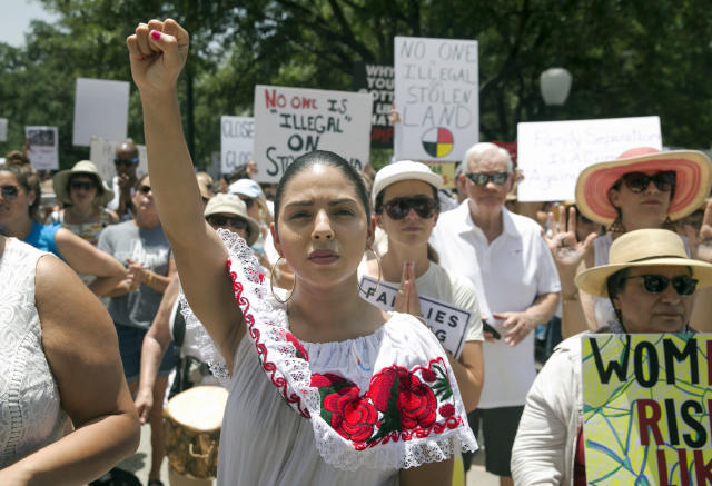 <p>Maria Montelongo raises her fist at the Families Belong Together rally at the Capitol in Austin, Texas, on Saturday, June 30, 2018. Thousands gathered at the Capitol to protest family separations on the border. (Jay Janner/Austin American-Statesman via AP) </p>