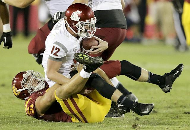 Washington State quarterback Connor Halliday is sacked by Southern California linebacker Morgan Breslin during the second half of an NCAA college football game in Los Angeles, Saturday, Sept. 7, 2013. (AP Photo/Chris Carlson)