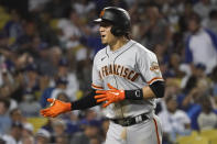 San Francisco Giants' Wilmer Flores celebrates his two-run home run during the ninth inning of the team's baseball game against the Los Angeles Dodgers on Wednesday, July 21, 2021, in Los Angeles. (AP Photo/Marcio Jose Sanchez)