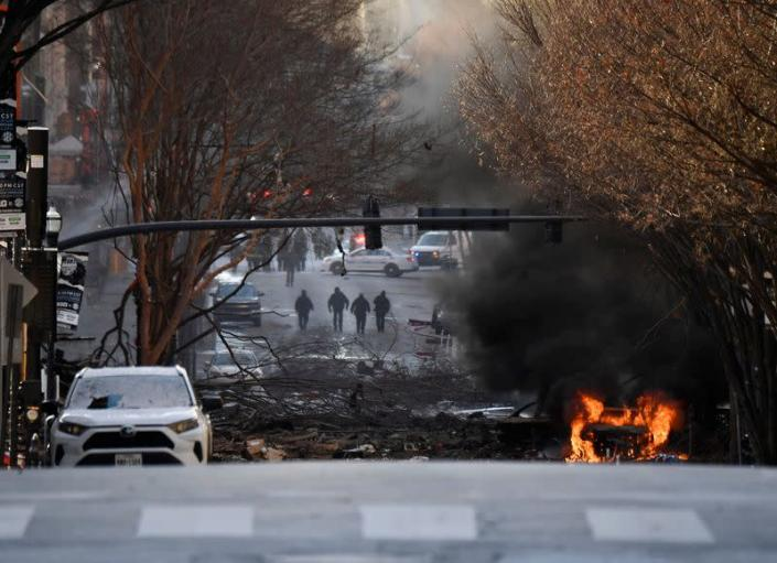 A vehicle burns near the site of an explosion in the area of Second and Commerce in Nashville