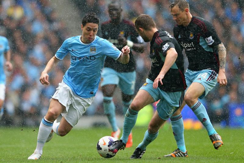 Running man: Samir Nasri in action for Manchester City against West Ham in 2014: Getty Images