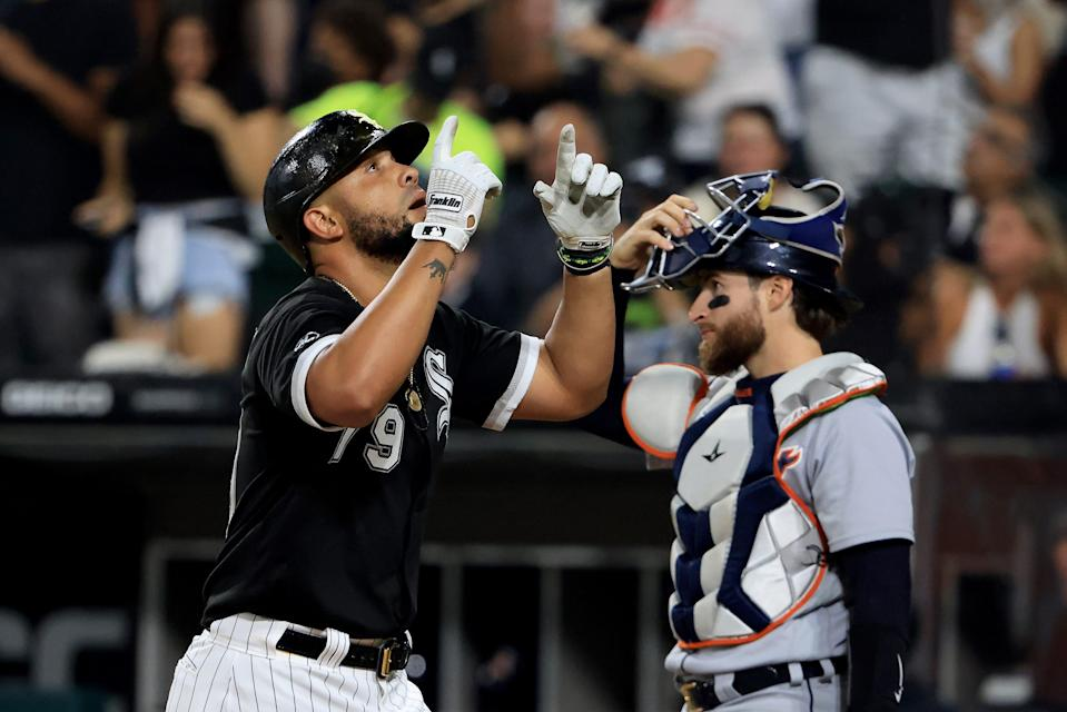 Jose Abreu of the Chicago White Sox points to the sky after hitting a home run during the third inning against the Detroit Tigers at Guaranteed Rate Field in Chicago on Friday, Oct. 1, 2021.