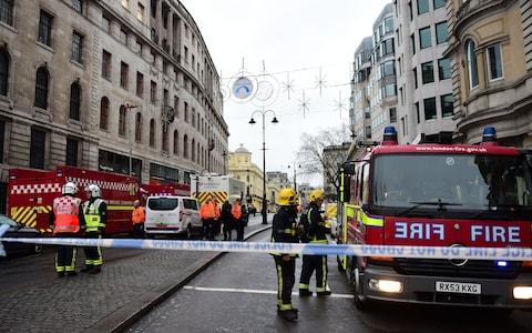 Firefighters behind a cordon on the Strand - Credit: David Mirzoeff/PA
