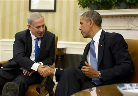 U.S. President Barack Obama shakes hands with Israeli Prime Minister Benjamin Netanyahu in the Oval Office of the White House in Washington