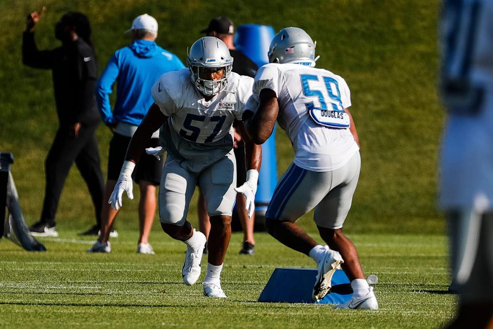Detroit Lions linebacker Anthony Pittman (57) and linebacker Tavante Beckett (59) work out during training camp at the practice facility in Allen Park, Wednesday, Aug. 4, 2021.