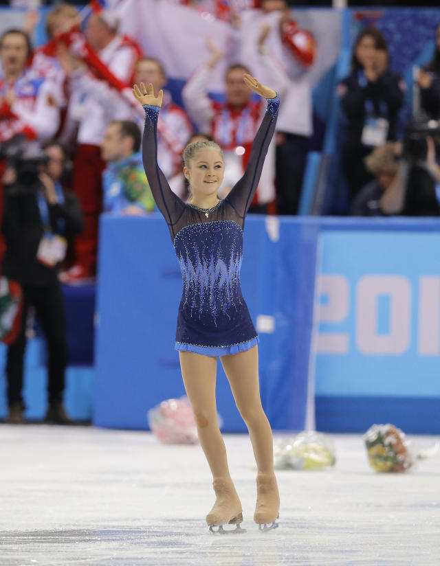 Yulia Lipnitskaya of Russia waves to spectators after competing in the women's team short program figure skating competition at the Iceberg Skating Palace during the 2014 Winter Olympics, Saturday, Feb. 8, 2014, in Sochi, Russia. (AP Photo/Vadim Ghirda)