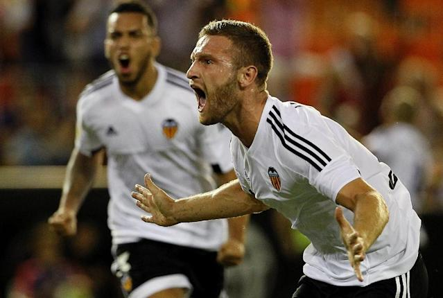 Valencia's German defender Shkodran Mustafi celebrates his goal during the Spanish league football match Valencia CF vs Granada CF at the Mestalla stadium in Valencia on September 25, 2015 (AFP Photo/Jose Jordan)