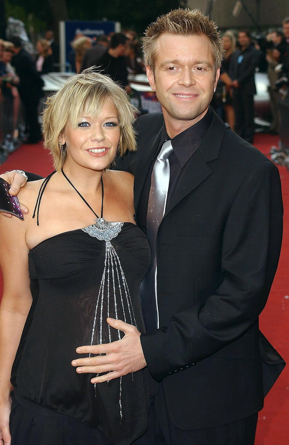 Suzanne Shaw and Darren Day arrive at the Celebrity Awards at London Television Centre on September 26, 2004 in London. The ceremony honours the year's most popular and successful stars. Voted for both by viewers and a panel of judges, categories include Celebrity Newcomer, Funniest Celebrity, International Celebrity, Sexiest Male Celebrity and Sexiest Female Celebrity. (Photo by David Westing/Getty Images)