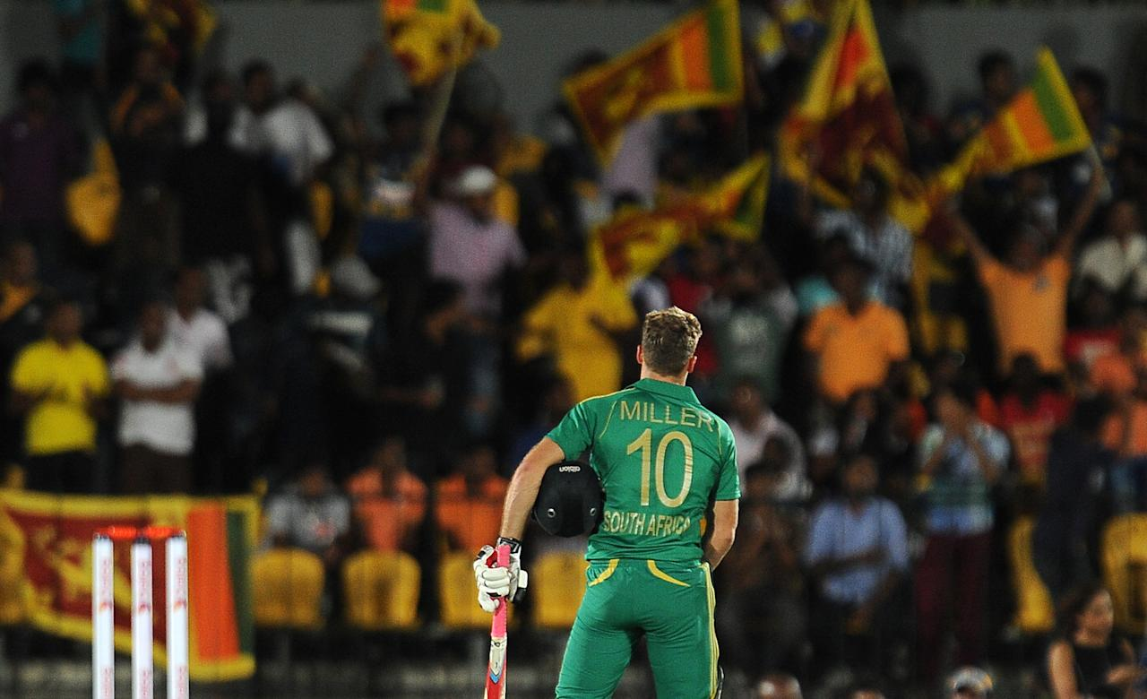 South African batsman David Miller walks back to the pavilion after his dismissal during the second Twenty20 cricket match between Sri Lanka and South Africa at the Suriyawewa Mahinda Rajapakse International Cricket Stadium in the southern district of Hambantota on August 4,2013. AFP PHOTO / LAKRUWAN WANNIARACHCHI