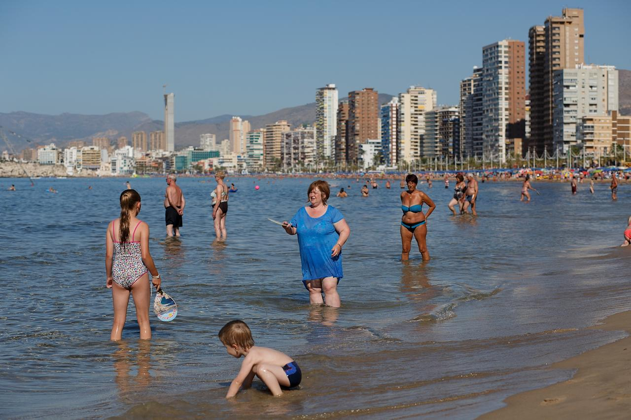 Terrified tourists flee 8ft shark spotted swimming close to Benidorm beach