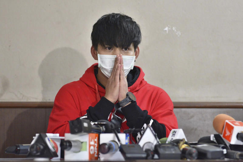 In this Sept. 18, 2019, photo, Ratchadech Wongtabut talks to reporters at the Bukkhalo Police Station in Bangkok, Thailand. Police have arrested Ratchadech the male model accused of taking an unconscious woman home, boasting online about his sexual exploits, and leaving her lifeless body in the lobby of his building. (AP Photo)