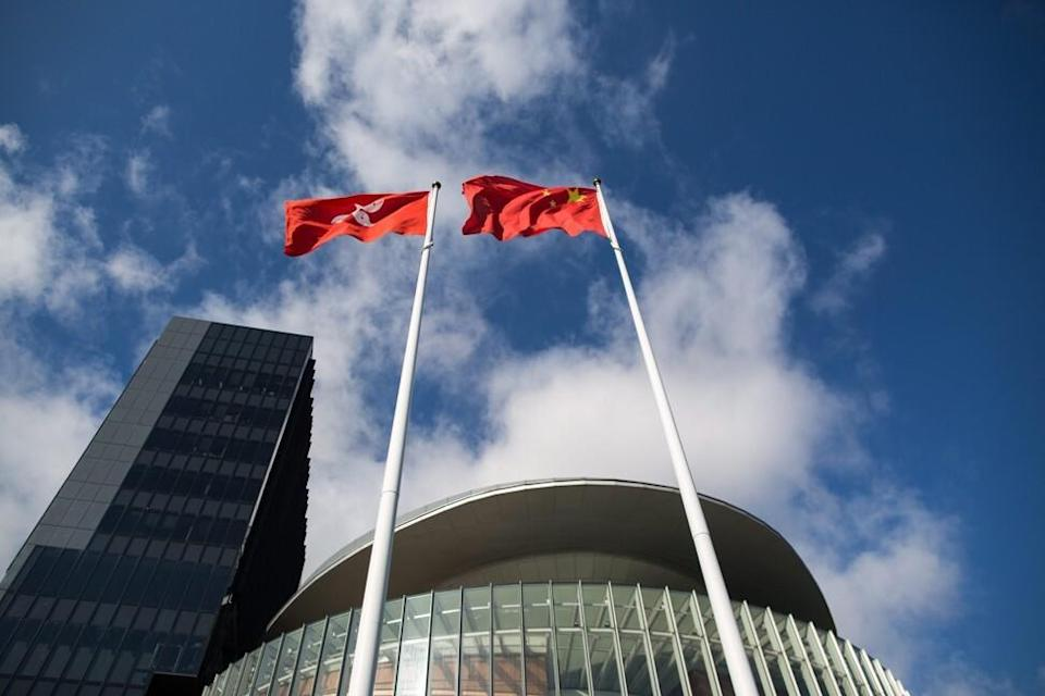 The Chinese flag and the Hong Kong flag fly on masts outside the Legislative Council in Hong Kong in 2015. Photo: EPA