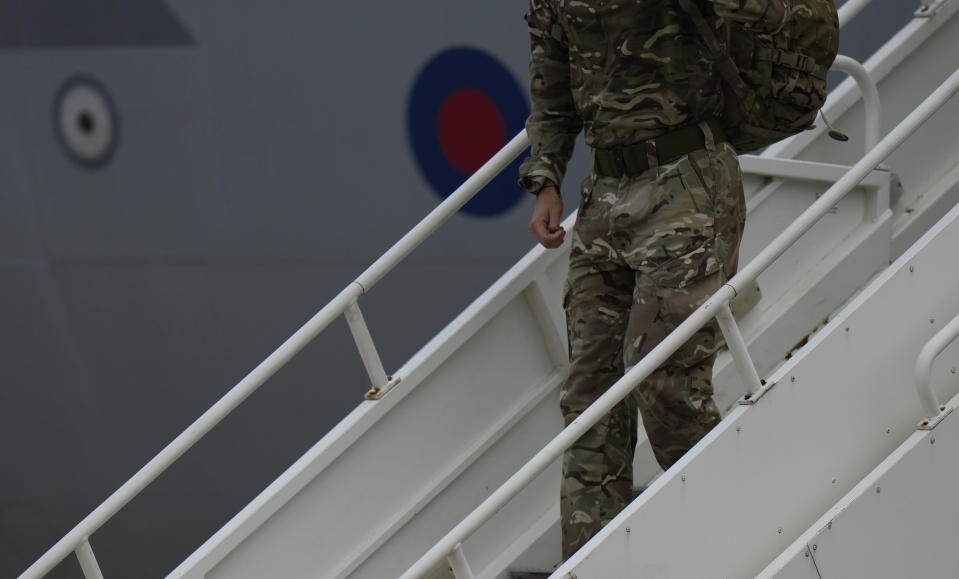 A member of the British armed forces 16 Air Assault Brigade disembarks a RAF Voyager aircraft after landing at Brize Norton, England, as they return from helping in operations to evacuate people from Kabul airport in Afghanistan, Saturday, Aug. 28, 2021. More than 100,000 people have been safely evacuated through the Kabul airport, according to the U.S., but thousands more are struggling to leave in one of history's biggest airlifts. (AP Photo/Alastair Grant, Pool)