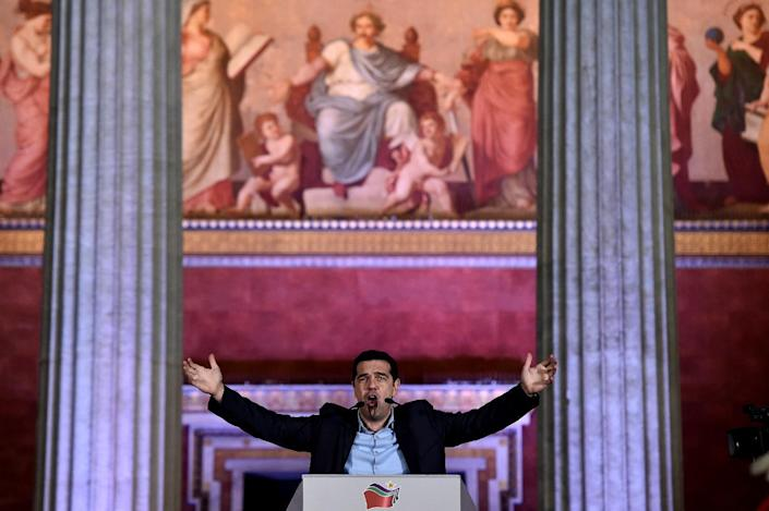 Prime Minister Alexis Tsipras, who has secured high-profile allies in his controversial drive against austerity, greets supporters after his Syriza party won Greece's January 2015 election (AFP Photo/Aris Messinis)