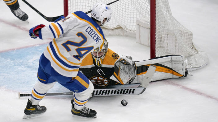 Boston Bruins goaltender Jeremy Swayman drops to the ice to make a save on a shot by Buffalo Sabres center Dylan Cozens (24) during the second period of an NHL hockey game Tuesday, April 13, 2021, in Boston. (AP Photo/Charles Krupa)