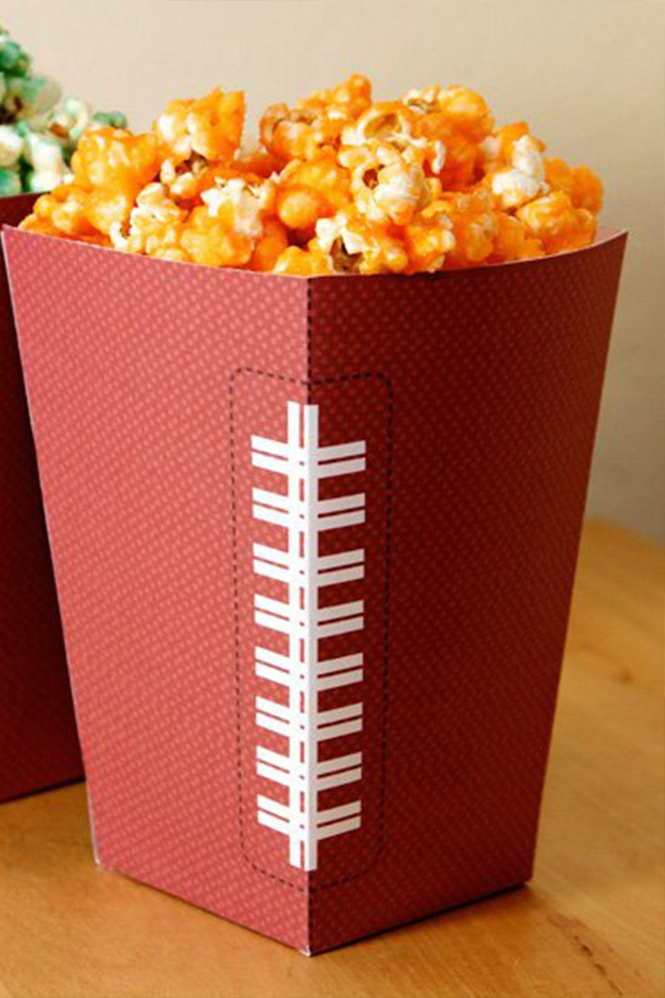 "<p>Add a fun twist to this simple snack with paper printables.<br></p><p><em><a href=""http://blog.hwtm.com/2012/01/free-football-party-printables-homemade-stadium-snack-recipes/"" rel=""nofollow noopener"" target=""_blank"" data-ylk=""slk:Get the tutorial and printables at Hostess With the Mostess »"" class=""link rapid-noclick-resp"">Get the tutorial and printables at Hostess With the Mostess »</a></em> </p>"