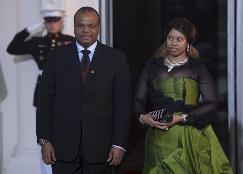King Mswati III of Swaziland and his wife arrive at the White House during the US Africa Leaders Summit on August 5, 2014 in Washington, DC