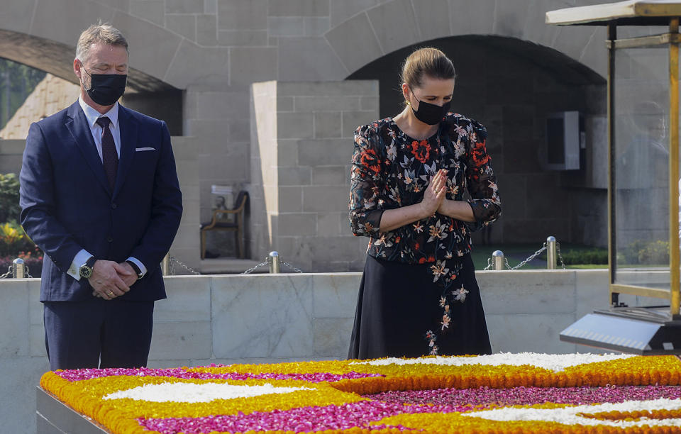 Danish Prime Minister Mette Frederiksen and her husband Bo Tengberg offer tributes at Rajghat, the memorial dedicated to the Indian independence leader, in New Delhi, India, Saturday, Oct. 9, 2021. (AP Photo)