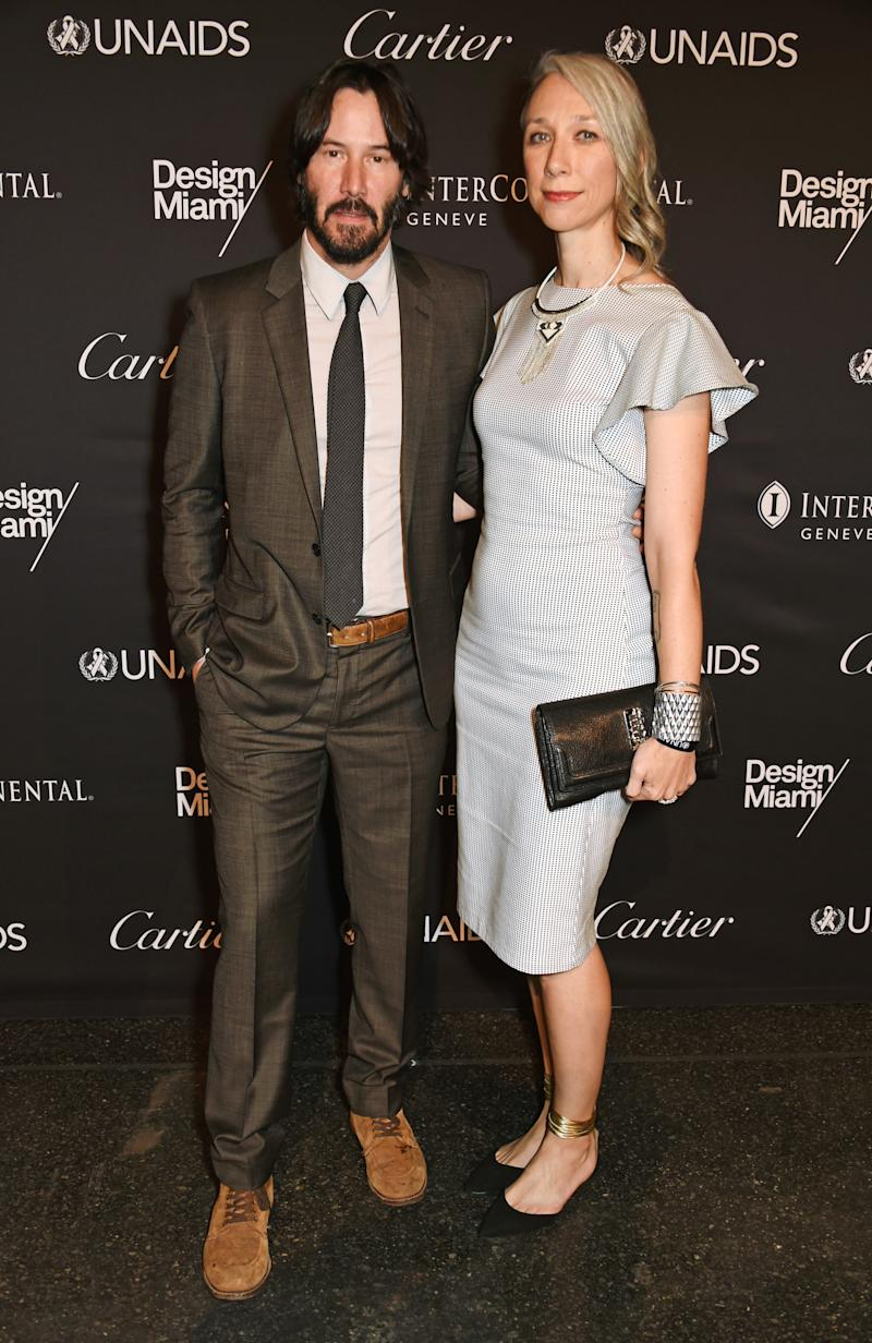 A photo of Alexandra Grant and Keanu Reeves on the red carpet at the UNAIDS Gala during Art Basel 2016 at Messe Basel on June 13, 2016 in Basel, Switzerland.