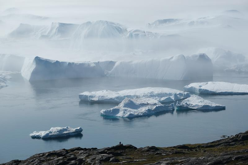 Icebergs float jammed into the Ilulissat Icefjord in a bank of fog during a week of unseasonably warm weather near Ilulissat, Greenland. (Photo: Sean Gallup/Getty Images)