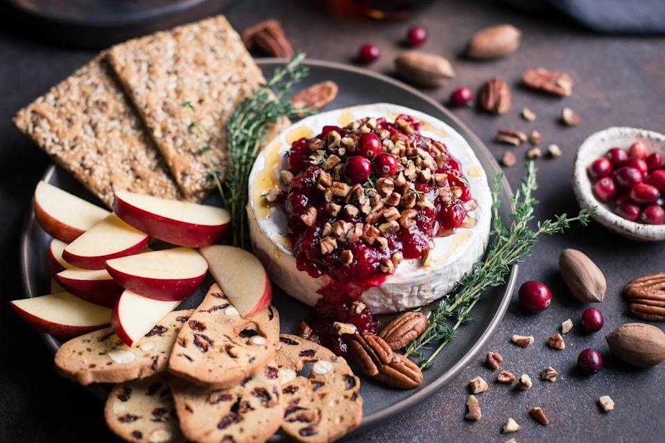 """<p>The winter has plenty of special occasions, but you don't have to wait for a holiday to make a delicious baked brie. Just whip this up whenever the mood strikes.</p> <p><a href=""""https://www.thedailymeal.com/recipe/baked-brie-with-pecans-cranberry-orange-chutney?referrer=yahoo&category=beauty_food&include_utm=1&utm_medium=referral&utm_source=yahoo&utm_campaign=feed"""" rel=""""nofollow noopener"""" target=""""_blank"""" data-ylk=""""slk:For the Baked Brie with Pecans and Cranberry Orange Chutney recipe, click here."""" class=""""link rapid-noclick-resp"""">For the Baked Brie with Pecans and Cranberry Orange Chutney recipe, click here.</a></p>"""