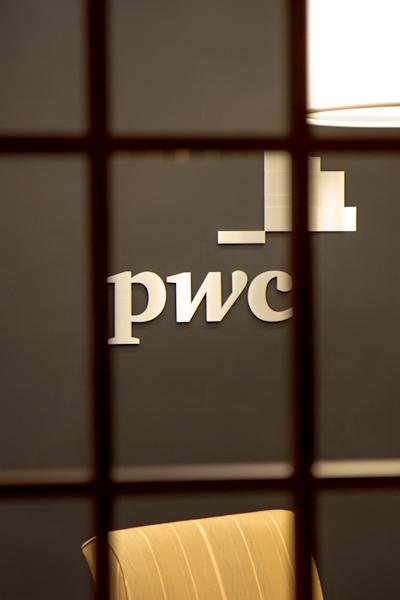 The PricewaterhouseCoopers office in Franklin, Tenn., is seen from outside its doors on Wednesday, Sept. 5, 2012. The Secret Service said is investigating the reported theft of copies houses Republican presidential candidate Mitt Romney's federal tax records during a break-in at the office. The company said there was no evidence that any Romney tax files were stolen. (AP Photo/Erik Schelzig)