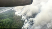 In this handout photo taken from video released by Russian Emergency Situations Ministry press service, an air view of a forest in the republic of Sakha also knows as Yakutia, Russia Far East, Sunday, July 18, 2021. Russia has been plagued by widespread forest fires, blamed on unusually high temperatures and the neglect of fire safety rules, with Sakha-Yakutia in northeastern Siberia being the worst affected region lately. (Russian Emergency Situations Ministry press service via AP)