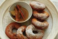 "These Peruvian doughnuts are made with pumpkin purée and served with a fragrant anise- and bay leaf–infused honey. <a href=""https://www.epicurious.com/recipes/food/views/picarones-con-miel-51185450?mbid=synd_yahoo_rss"" rel=""nofollow noopener"" target=""_blank"" data-ylk=""slk:See recipe."" class=""link rapid-noclick-resp"">See recipe.</a>"