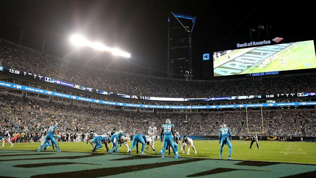 After being caught on video punching a fellow spectator, a Carolina Panthers fan has been charged with simple assault.