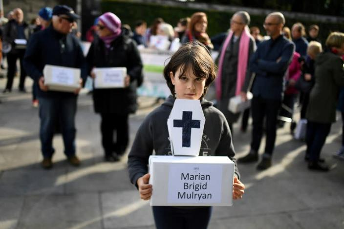 FILE PHOTO: Matilda Kelly holds a funeral box at a funeral procession in remembrance of the bodies of the infants discovered in a septic tank, in 2014, at the Tuam Mother and Baby Home, in Dublin