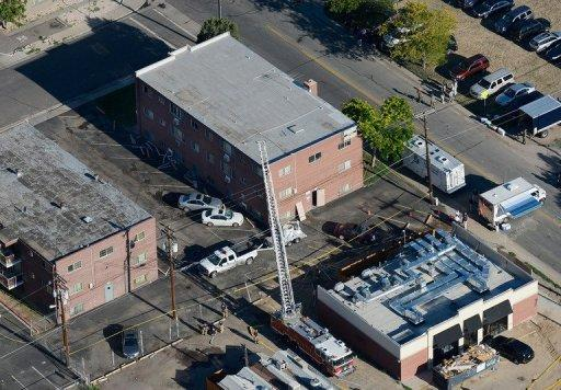 """Seen from the air, police and fire fighters surround the booby-trapped apartment of suspect James Holmes after he went on a shooting rampage at nearby Century 16 movie theatre during an early morning screening of the new Batman movie, 'The Dark Knight Rises,' in Aurora, Colorado. Police said Saturday they had defused the """"major remaining threats"""" in the booby-trapped apartment of the gunman"""