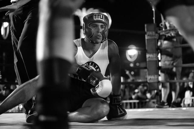 <p>Jared Martinez looks around after getting knocked to the deck by opponent Eddie Aguilar at the Brooklyn Smoker in Coney Island, Brooklyn, on Aug. 24, 2017. (Photo: Gordon Donovan/Yahoo News) </p>