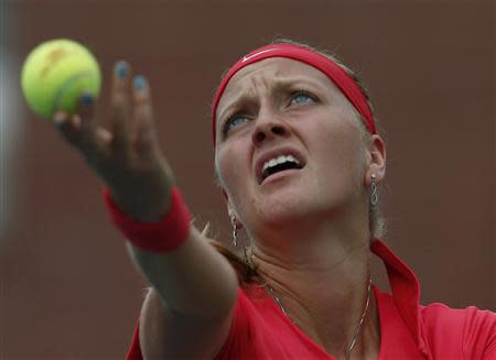 Petra Kvitova of the Czech Republic serves to Alison Riske of the U.S. at the U.S. Open tennis championships in New York August 31, 2013. REUTERS/Eduardo Munoz