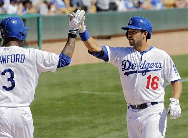 Los Angeles Dodgers' Andre Ethier (16) is greeted by Carl Crawford after Ethier's two-run home run in the first inning of a spring exhibition baseball game against the Oakland Athletics, Monday, March 10, 2014, in Glendale, Ariz. (AP Photo/Mark Duncan)