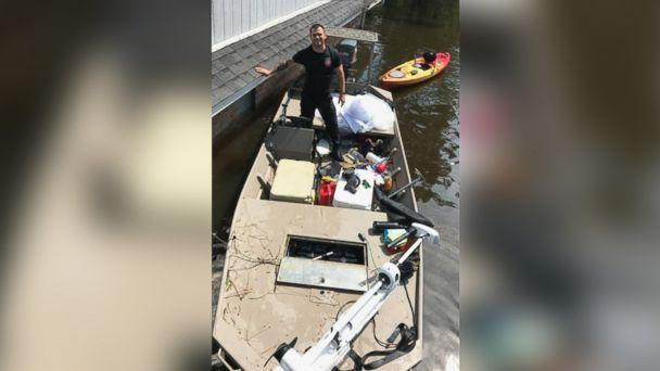 PHOTO: Kyle Parry, 35, a firefighter from Lumberton, Texas, found his fiance Stephanie Hoekstra's, 33, wedding gown untouched by the floodwaters of Hurricane Harvey on Aug. 31.  (Stephanie Hoekstra )