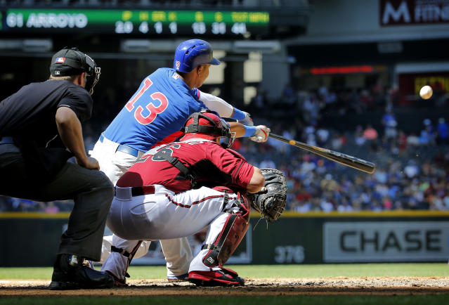 Chicago Cubs' Starlin Castro hits as Arizona Diamondbacks' Miguel Montero catches during the second inning of an exhibition spring training baseball game, Saturday, March 29, 2014, in Phoenix. (AP Photo/Matt York)