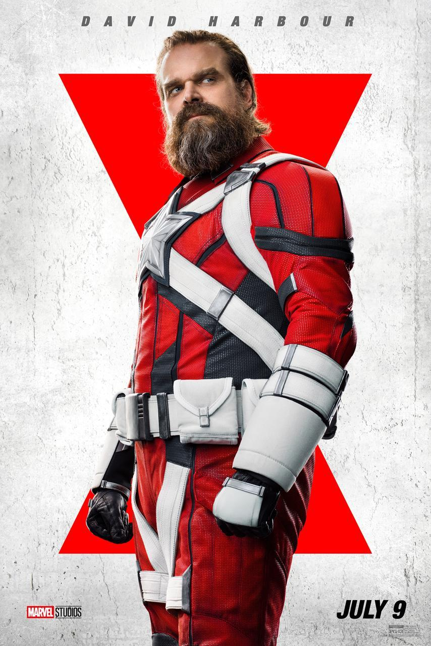 A bearded David Harbour as the Red Guardian, wearing a red suit with white accents and a white star on his chest.
