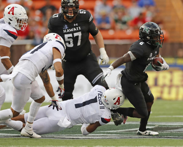 Arizona linebacker Tony Fields II (1) tries to pull down Hawaii wide receiver Cedric Byrd II (6) during the second quarter of an NCAA college football game Saturday, Aug. 24, 2019, in Honolulu. (AP Photo/Marco Garcia)